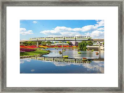 Monorail Cruise Over The Flower Garden. Framed Print