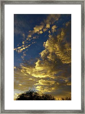 Monsoon Warmth Framed Print