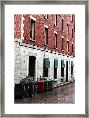 Montreal Garbage Cans Framed Print by John Rizzuto