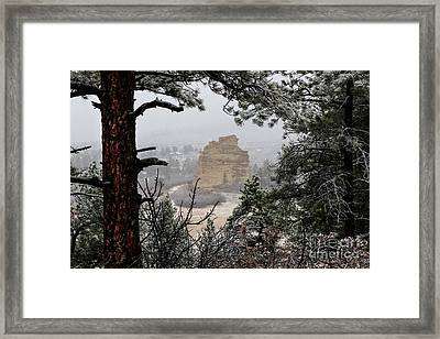 Monument Rock In The Snow Framed Print
