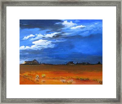 Monument Valley Clouds Framed Print by LaVonne Hand