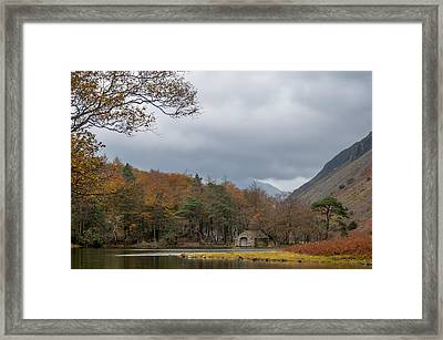 Moody Clouds Over A Boathouse On Wast Water In The Lake District Framed Print