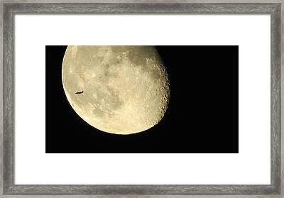 Moon And Plane Over Sanibel Framed Print by Melinda Saminski