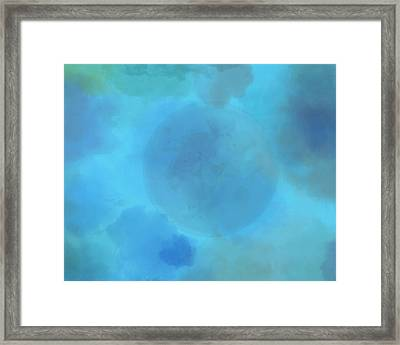 Moon In Clouds Framed Print by Dan Sproul