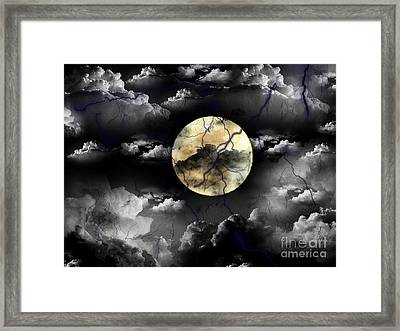 Moon In The Storm Framed Print