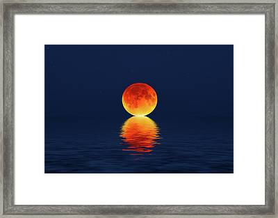 Moon Kissing The Sea Framed Print