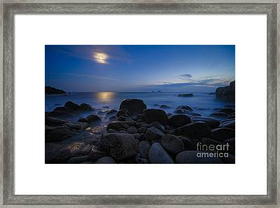 Moon Over Rocks At The Shore Framed Print by Royce Howland