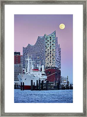 Framed Print featuring the photograph Moon Over The Elbe Philharmonic Hall by Marc Huebner
