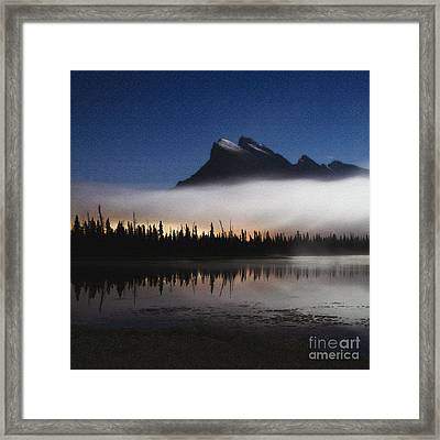 Moonlight And Town Lights Framed Print by Royce Howland