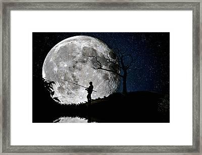 Moonlight Fishing Under The Supermoon At Night Framed Print by Justin Kelefas