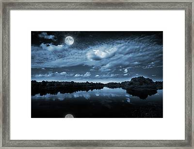 Moonlight Over A Lake Framed Print by Jaroslaw Grudzinski