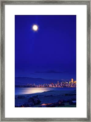 Moonlit Vancouver Framed Print by Paul Kloschinsky