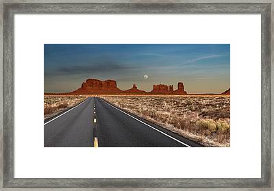 Framed Print featuring the photograph Moonrise Over Monument Valley by Lou Novick