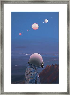 Moons Framed Print