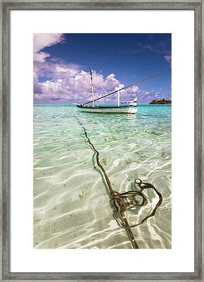 Moored Dhoni. Maldives Framed Print by Jenny Rainbow