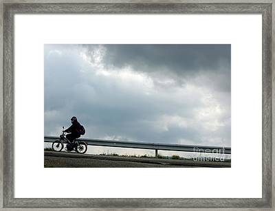 Moped On A Road Against A Stormy Sky Framed Print by Sami Sarkis