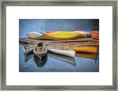 Moraine Lake Canoes Framed Print