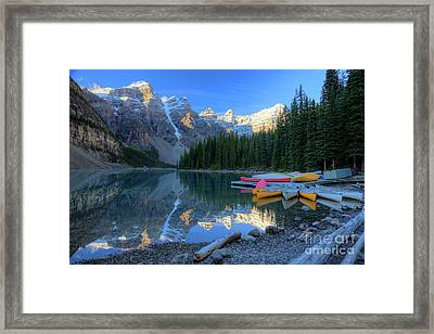 Moraine Lake Sunrise Blue Skies Canoes Framed Print