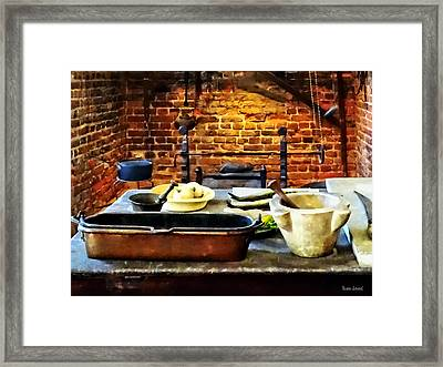 Mortar And Pestles In Colonial Kitchen Framed Print