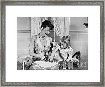 Mother And Daughter Baking Cookies Framed Print by H. Armstrong Roberts/ClassicStock