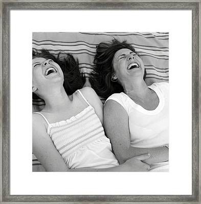 Mother And Daughter Laughing Framed Print