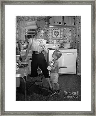 Mother And Son With Milk, C.1950s Framed Print by Debrocke/ClassicStock