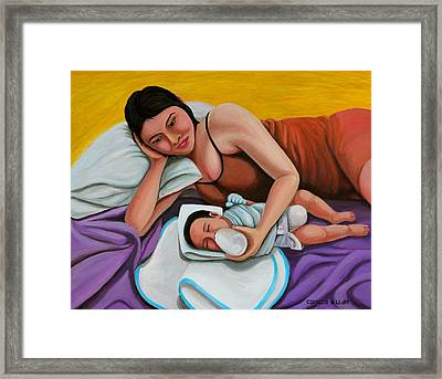Mother Feeding Her Baby Framed Print by Cyril Maza