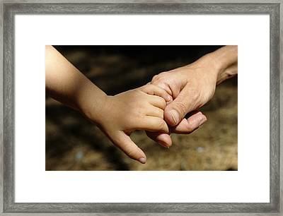 Mother Holding Baby Daughter's Hand Framed Print by Sami Sarkis