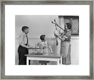 Mother Showing Turkey To Children Framed Print by H. Armstrong Roberts/ClassicStock