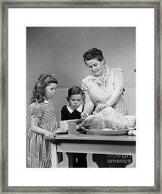 Mother Stuffing Thanksgiving Turkey Framed Print by H. Armstrong Roberts/ClassicStock