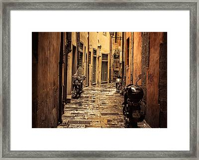 Motorcycle Alley Framed Print by Chris Fletcher