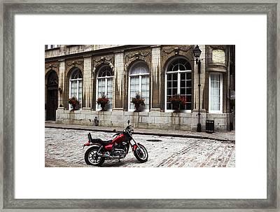 Motorcycle In Old Montreal Framed Print by John Rizzuto