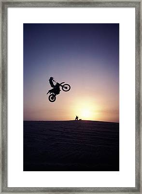 Motorcyclist In Mid-air Jump Framed Print by James Porto