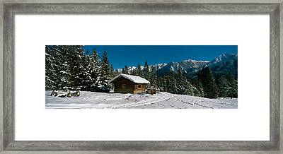 Mountain Cabin And Snow Covered Forest Framed Print