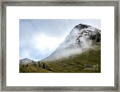Mountain Range Snow Covered Framed Print by Bernard Jaubert