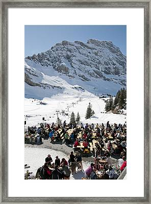 Mountain Restaurant In Engelberg Skiers In The Spring Sunshine At A Cafe In Swiss Ski Resort Framed Print