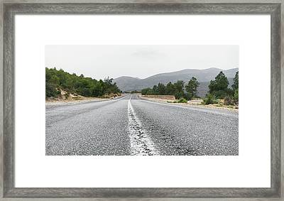 Mountain Road Framed Print by Tom Gowanlock