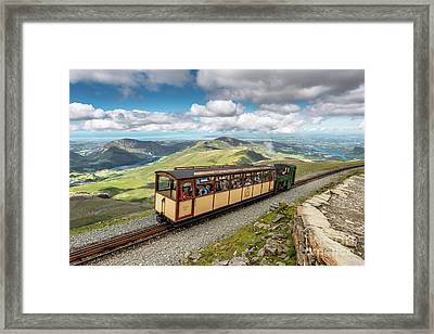 Mountain Train Framed Print by Adrian Evans