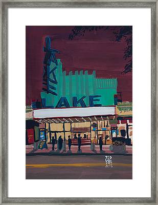 Movie Night In The Village Framed Print by Ted Gordon