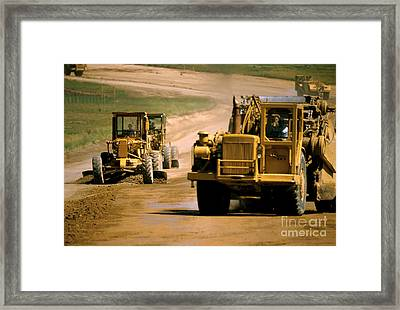 Moving Dirt Framed Print by Jerry McElroy