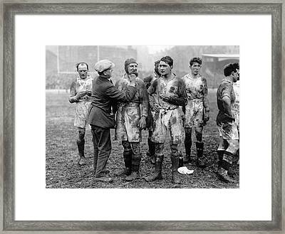 Muddy Players Framed Print by Hulton Collection