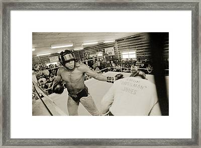Muhammad Ali Spars With Ernie Jones Framed Print