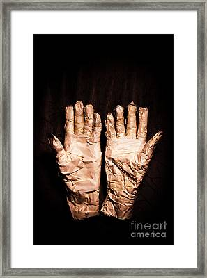 Mummy's Hands Over Dark Background Framed Print