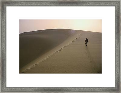 Murrah Tribesman Walking On A Large Framed Print by Thomas J Abercrombie