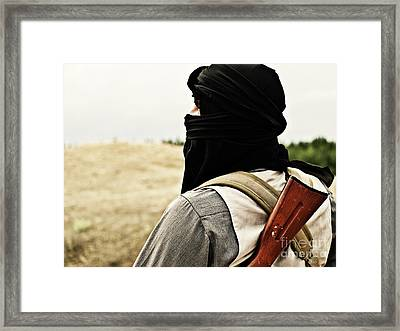 Muslim Rebel Framed Print by Oleg Zabielin