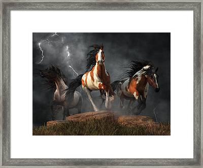 Mustangs Of The Storm Framed Print by Daniel Eskridge