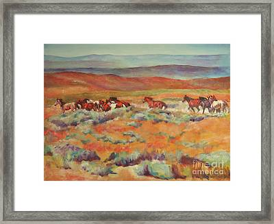 Mustangs Running Near White Mountain Framed Print by Karen Brenner