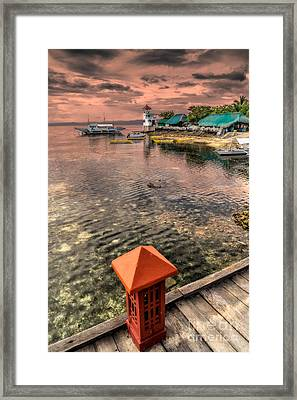 Nalusuan Island Sunset Framed Print by Adrian Evans