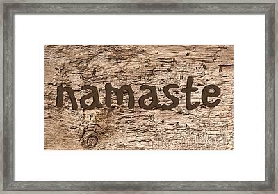 Namaste Sign Rough Wood Background Framed Print by Edward Fielding