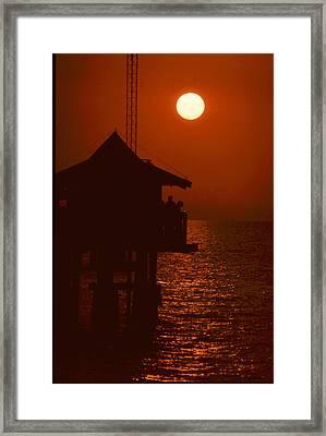 Naples Pier Sunset Framed Print by Michael L Kimble